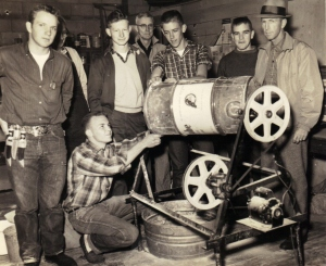 C. Q. Hoover and the Ag boys working on a rat control device